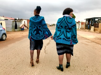 Me and my Mom walking down the street in Soweto at a family funeral. Dressed in Thabo Makhetha's Basotho Cape Coats